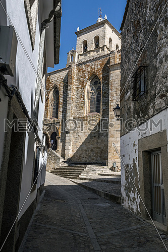 Caceres, Spain - july 13, 2018: Santa Maria's Cathedral, romantic style of transition to Gothic, with some Renaissance elements, placed in the square of Santa Maria, Caceres, Spain
