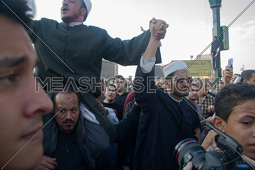 Egyptian muslim sheikhs holding hands during a revolution in egypt