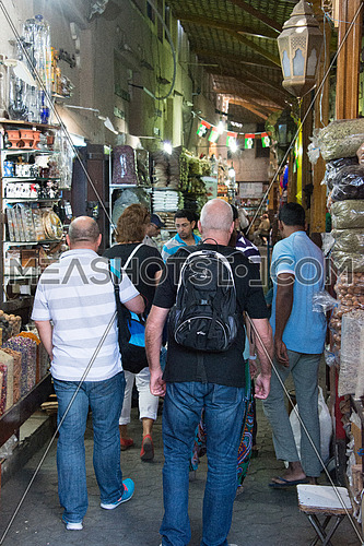 tourists walking in an old grand bazar