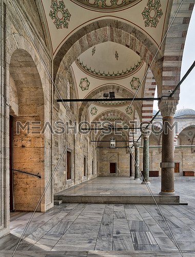 Passage leading to Fatih Mosque, a public Ottoman Baroque style mosque, with columns, arches and marble floor, Fatih district, Istanbul, Turkey