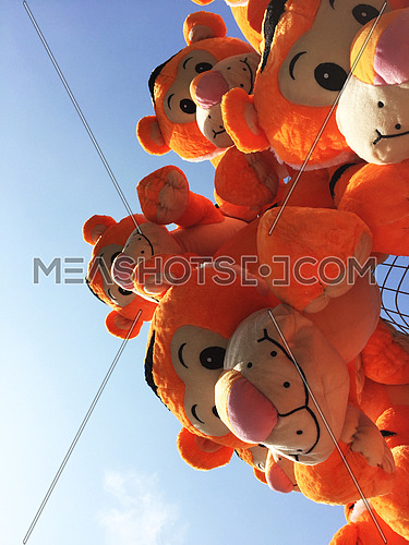 tiger soft toys against blue sky