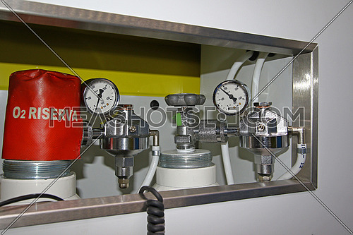 Top gages on medical oxygen tanks in a modern ambulance