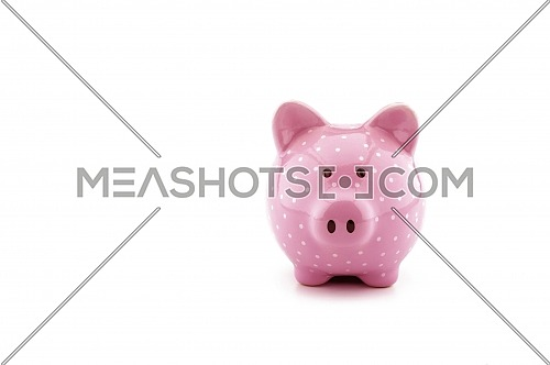 Front view of a pink ceramic piggy bank on a white background with copy space