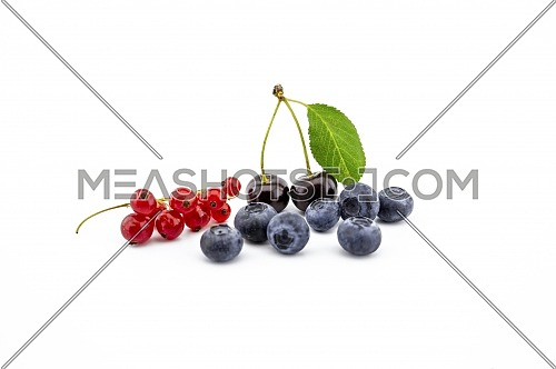 Fresh assorted berries including blueberries, cherries and red currants isolated on white background