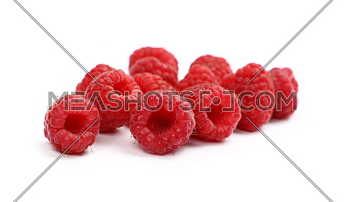 Group of fresh red ripe mellow raspberry berries isolated on white background, close up, low angle view