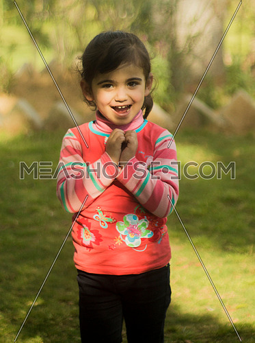 A little Palestineian girl in a garden