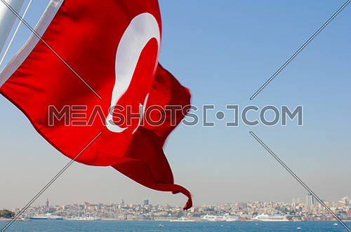 The Turkish flag waving on a ferry over the Bosphorus in Istanbul
