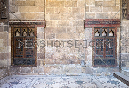 Two embedded wooden ornate cupboard, in one of the rooms of Beit (house) of El Harrawi, an old Mamluk era historic house in Cairo, Egypt