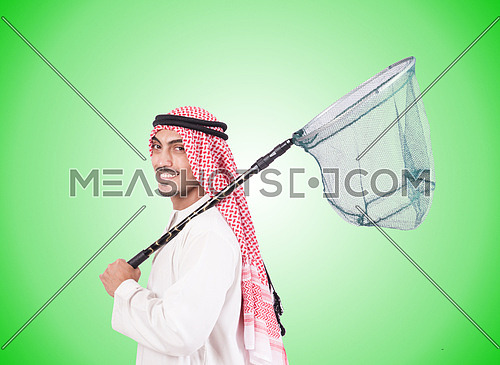 Arab businessman with catching net against gradient
