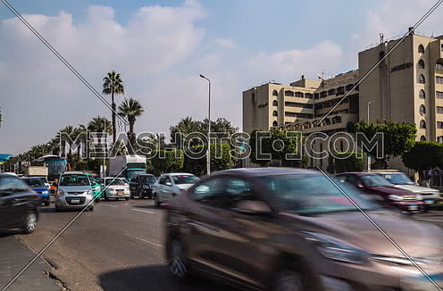 Zoom Out Shot for traffic at Salah Salim Street showing Le Meridien Hotel in background at Daytime