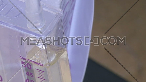 Close shot for Liquid flows into medical container