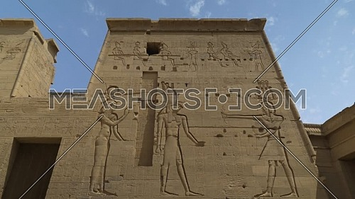 Track out shot for Writings on the main entrance of Temple of Phila at Aswan - Egypt by day