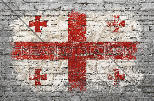 Grunge distressed flag of Georgia painted on old weathered grey brick wall