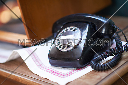 retro vintage black cable telephone on old wooden table