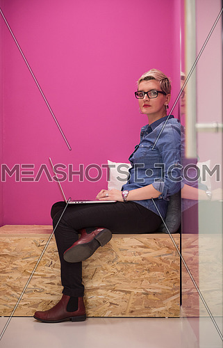 young woman in crative box working on laptop computer, startup business modern office room  interior