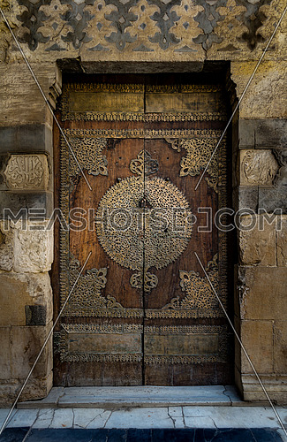 One of the doors surrounding the main court of Al-Sultan Al-Zahir Barquq mosque. Al-Moez Street, Old Cairo, Egypt