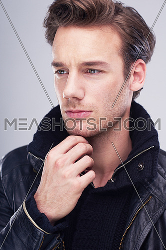handsome young man portrait isolated on white background in studio