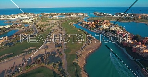Aerial shot flying above Al Gouna and boat passing at Day