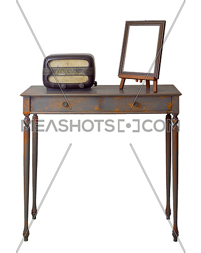 Vintage Furniture - Retro wooden vintage table with two drawers painted in grey and orange, wooden ornate brown desktop photo frame and old radio, including clipping path