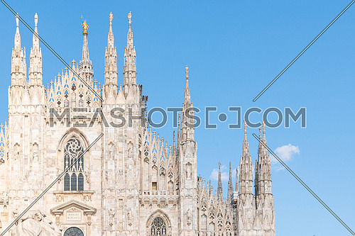 """Details of Duomo with the golden statue name """"Madonnina"""" on the top of the main spire"""