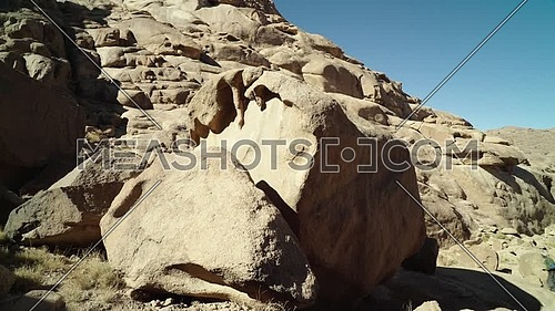 Follow shot for a big rock in Sinai Mountain at day.