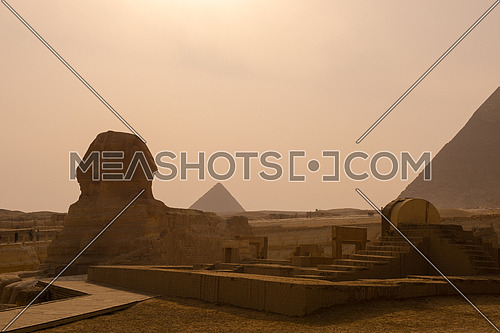 beautiful profile of the great sphinx including pyramids of menkaure and khafre in the background
