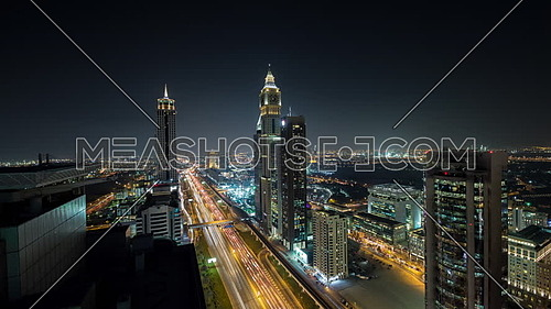 Long shot for Dubai City showing shaikh zayed towers and road at night