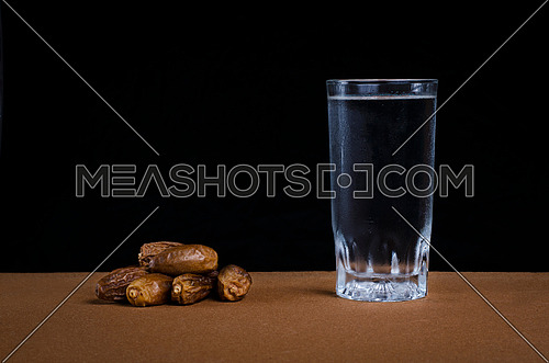 Dates and water representing breaking fast concept during holy month of ramadan