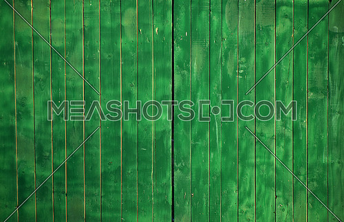 Close up background texture of green uneven painted wooden planks, rustic style fence