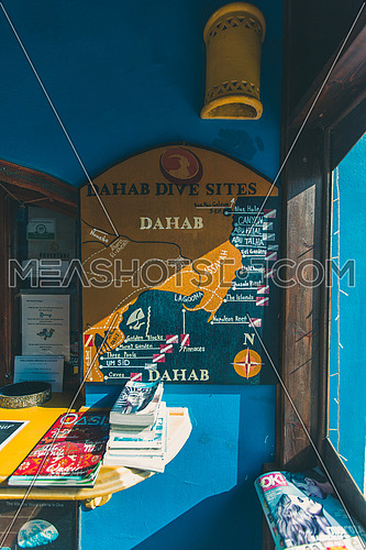 close up shot for a painted mar for the famous diving spots of Dahab hanged to wall at day.