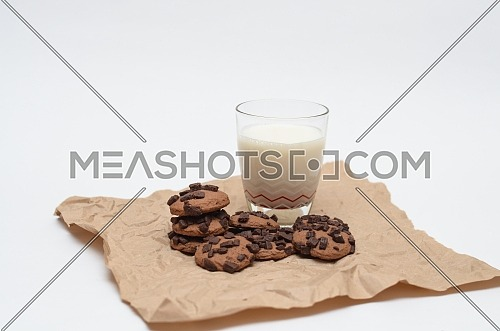 A glass of milk and chocolate chips cookies