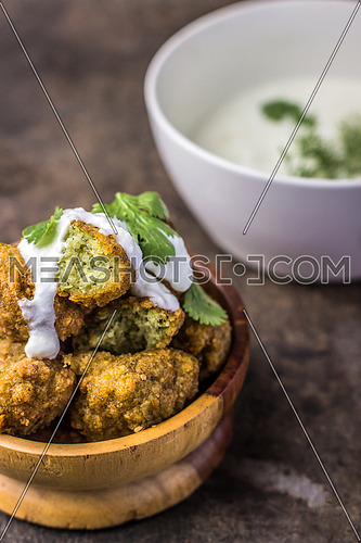Falafel a traditional Middle Eastern food in a wooden bowl