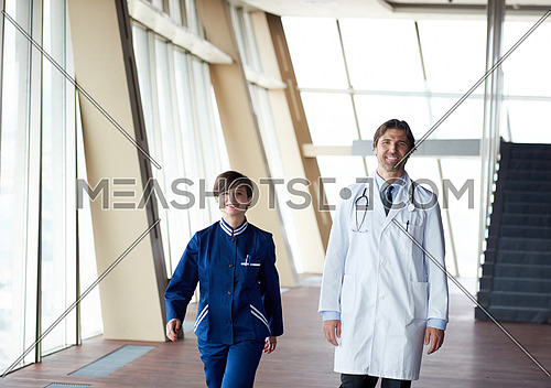 doctors team walking in modern hospital corridor indoors, poeople group