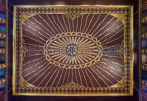 Wooden golden ornate ceiling with design based on sun rays inspired by the old flag of the ottoman empire at the public mosque of The Manial Palace of Prince Mohammed Ali Tewfik, Cairo, Egypt
