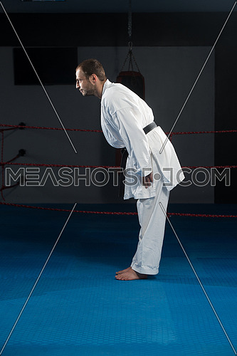 Young Man Practicing His Karate Moves - White Kimono - Black Belt