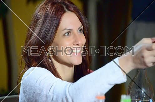 Close up for female smiling and giving an empty cup