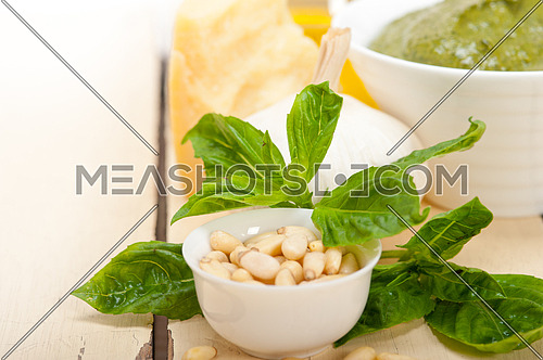 Italian traditional basil pesto sauce ingredients on a rustic table