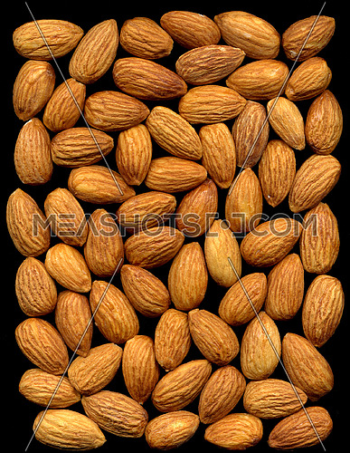 almonds on black background