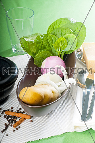 bowl of fresh vegetable with spice and mortar beside,basic ingredients for a soup recipe