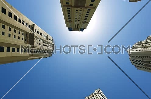 Low Angle shot panning showing Jbr Towers in Dubai