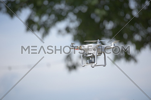 aerial photography,  quadcopter  drone flying over the city. New digital photo and video technology