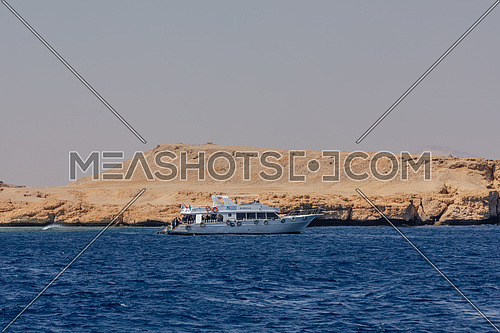 Long shot from Red Sea Yacht sails beside Ras Muhammed Island by day