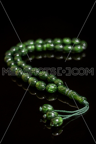 a green chaplet isolated on a black background