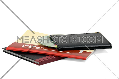 assorted notebooks with a cd flat piled on white background