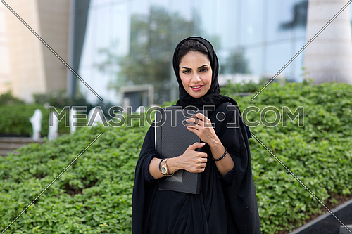 Saudi female student going out after finishing her class