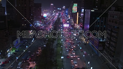 Fly Over for Al Mohandseen area revealing Gamet AL Dowal Street 22th of March 2018 in Giza  at Night
