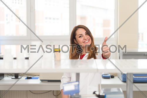 Portrait Of A Woman Student In A Chemistry Lab Smiling And Looking In The Camera