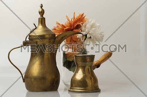 oriental brass coffee serving utensils isolated on grey