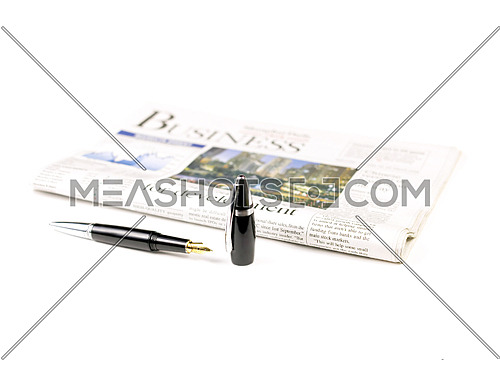 newspaper and pen on white background