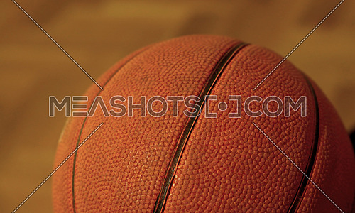 Close up one old vintage basketball ball on floor, low angle side view